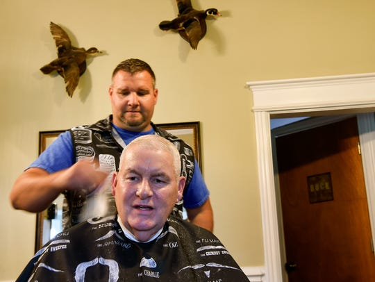 Mike Cotharn talks with barber Jed Jones about people