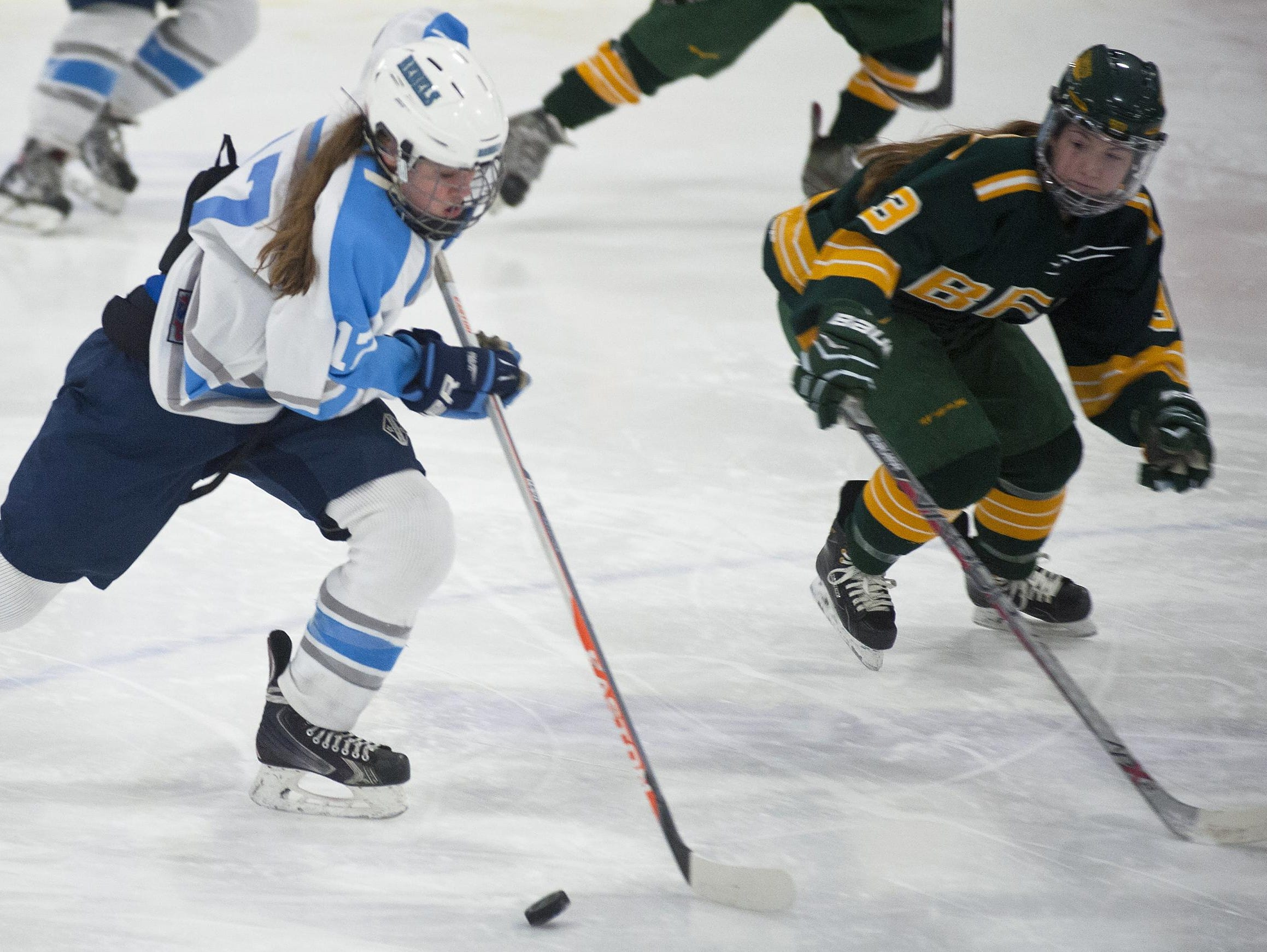 South Burlington's Katie Young, left, skates out of her zone past BFA-St. Albans' Riley Yandow during a game last season.