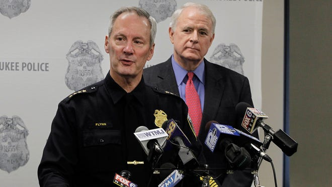Milwaukee Police Chief Edward Flynn, shown with Mayor Tom Barrett, announces his retirement in January.