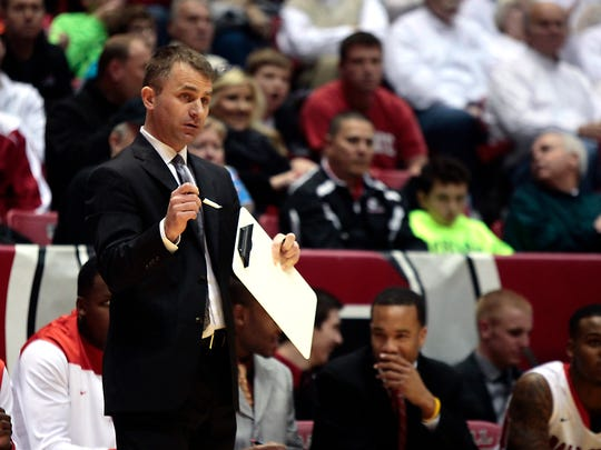 Ball State basketball coach James Whitford gives instructions. Ball State faced off with Butler in a basketball game at Worthen Arena on Nov. 23, 2013.