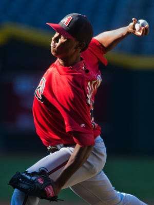 Jose Martinez pitches during instructional league play at Chase Field against the Oakland Athletics in October, 2013. Martinez is one of five players who completed the Diamondbacks' Dominican academy in Boca Chica and will be graduating on Friday.