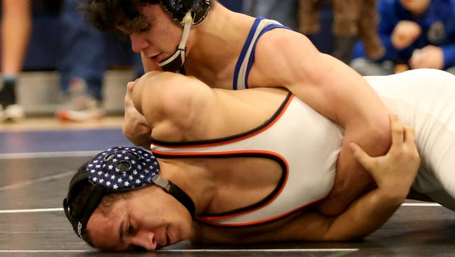 Olympic wrestler Alec Acfalle came home from Mat Classic with a second-place finish for the Trojans.