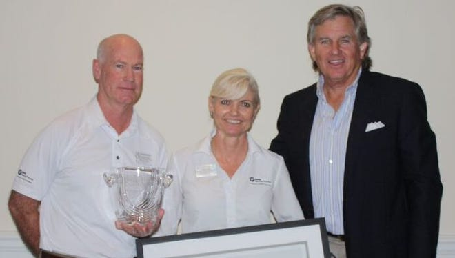 Web.com Tour president Bill Calfee, left, presents the Best Player Experience Award to BMW Charity Pro-Am presented by SYNNEX Corporation Tournament Director Marshall Bettendorf, left, and Director of Operations Cathy Miller.
