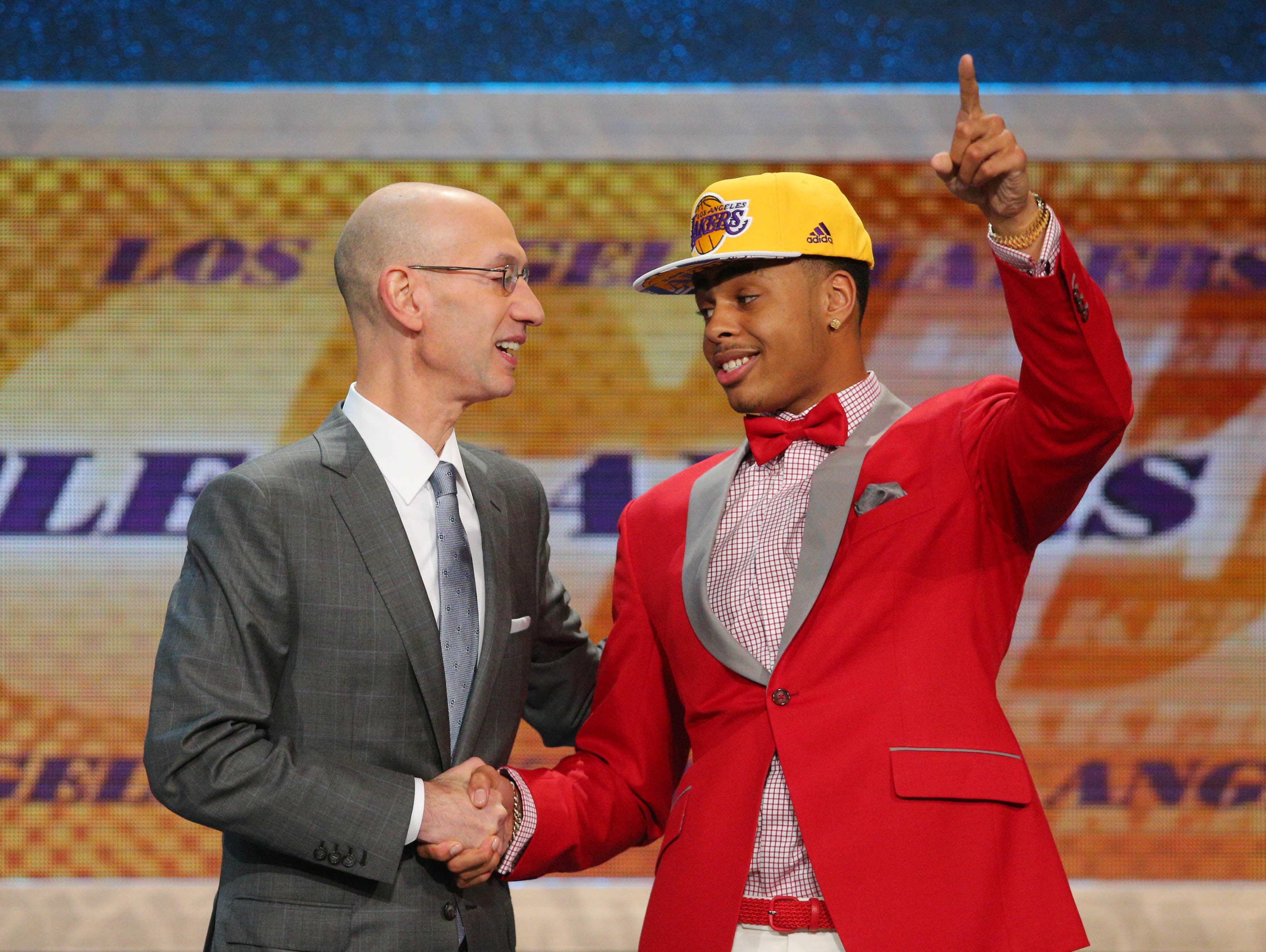 Jun 25, 2015; Brooklyn, NY, USA; D'Angelo Russell (Ohio State) shakes hands with NBA commissioner Adam Silver after being selected as the number two overall pick to the Los Angeles Lakers in the first round of the 2015 NBA Draft at Barclays Center. Mandatory Credit: Brad Penner-USA TODAY Sports