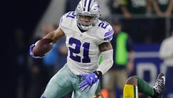 Dallas Cowboys' Ezekiel Elliott breaks away for a first