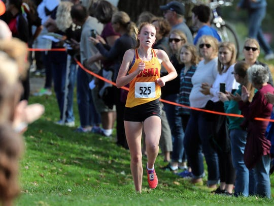 DSHA's Meghan Scott approaches the finish line to place first in a sectional cross-country meet Saturday at Lincoln Park.