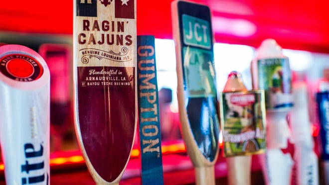The tap handle for Bayou Teche Brewing's Ragin' Cajuns beer is pictured at The Tap Room in Lafayette, La., Wednesday, Sept. 16, 2015.