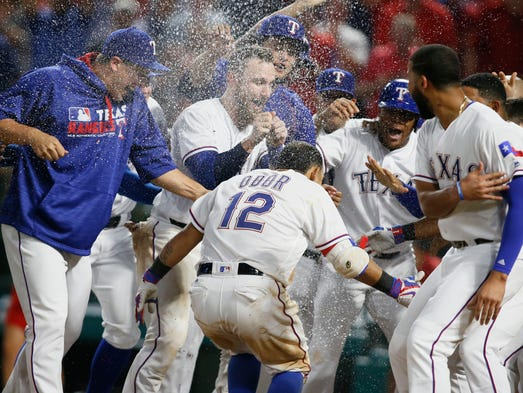 Aug. 30: Rangers second baseman Rougned Odor is mobbed