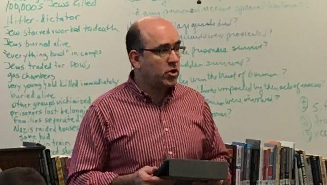 Rick Zimmerman teaches a class at Deerborn High School.