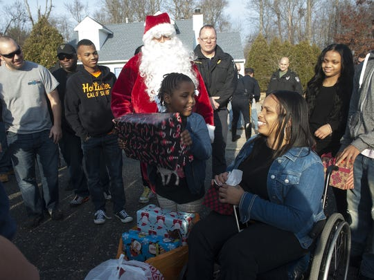The Winslow Township Police Department, with assistance from the Winslow Township Fire Department deliver presents to a family who suffered tragedy this year.