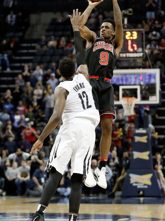FILE - In this March 15, 2018, file photo, Memphis Grizzlies' Tyreke Evans (12) fouls Chicago Bulls' Antonio Blakeney (9) on a 3-point attempt in the final seconds of an NBA basketball game Thursday, March 15, 2018, in Memphis, Tenn. Nearly a third of the 30 NBA teams are brutally bad this season and it's hard to believe some aren't losing on purpose. Phoenix, Memphis, Atlanta, Orlando, Dallas, Sacramento, Brooklyn, Chicago and New York should all lose 50 or more games, and only the Nets aren't motivated to lose--they don't own their first-round pick. (AP Photo/Mark Humphrey, File)