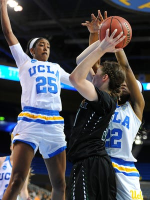 Hawaii's Megan Huff looks to shoot over UCLA's Monique Billings (25) and Kennedy Burke, right, during the Rainbow Wahine's loss in the NCAA women's basketball tournament on Saturday night.