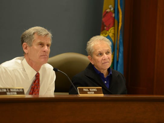 Paul Kuhns, mayor of Rehoboth and Sharon Lynn, city manager, listen as citizens speak during the commissioners meeting on Monday, Nov. 6, 2017.