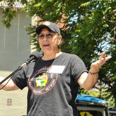 As a gust of wind blows her hat off, Cheryl Gore, of Rutherfordton, participates in the annual March against Monsanto.