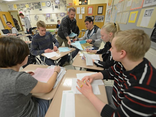 Students get their exams papers back from AP Psychology