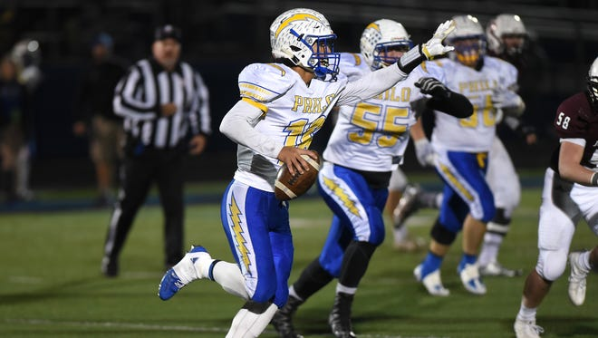 Philo's Isaac Gill instructs one of his receivers against John Glenn.