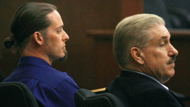 Levi Wilson, left, and his attorney, Arlon Stoker, listen Feb. 19 during a hearing for Wilson at Aztec District Court in Aztec.