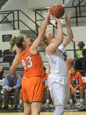 Abilene Christian's Sydney Shelstead, right, puts up a shot as Texas-Rio Grande Valley's Tristan Murphy defends. ACU beat the Vaqueros 70-54 in a Preseason WNIT consolation game Saturday, Nov. 19, 2016 at Moody Coliseum. Shelstead a game-high 26 points and 14 rebounds for the Wildcats.