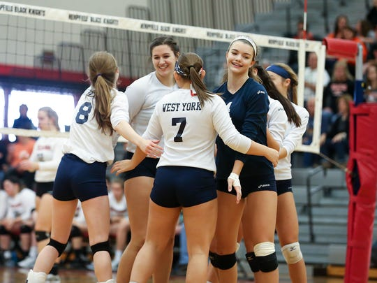 West York celebrates a point during their 3-0 win over Palmyra in the second round of the PIAA Class 3A girls' volleyball championships at Hempfield High School, Landisville, on Saturday, November 12, 2016.