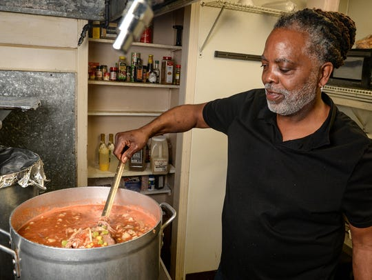 Melvin Mattison stirs Brunswick Stew at Grits and Gravy