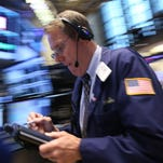 epa04826696 Traders work on the floor of the New York Stock Exchange (NYSE) at the start of the trading day in New York, New York, USA, 01 July 2015. After steep selloffs on 30 June 2015 on global financial markets, stock prices were more stable on 01 July 2015, with small losses on some European indices and small gains on others and on Wall Street.  EPA/ANDREW GOMBERT ORG XMIT: AGX03