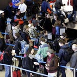 Travelers line up at a security checkpoint area in Terminal 3 at O'Hare International Airport on  Nov. 29, 2015, in Chicago.
