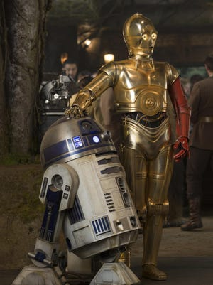"R2-D2, left, and Anthony Daniels as C-3PO in a scene from the new film, ""Star Wars: The Force Awakens,"" directed by J.J. Abrams."