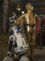 """R2-D2, left, and Anthony Daniels as C-3PO are seen in """"Star Wars: The Force Awakens."""" Oscar-winner John Williams wrote the score for all seven """"Star Wars"""" films. Oregon Symphony Association will present """"Star Wars and More: The Music of John Williams"""" at 8 p.m. May 8 at Smith Auditorium, Willamette University."""