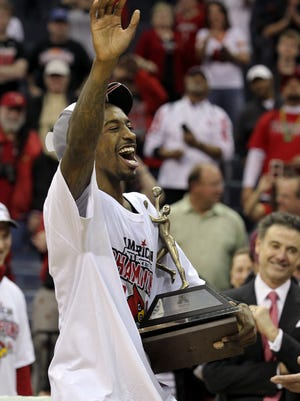 U of L's Russ Smith waves to the crowd after he was named the Most Outstanding Player of the AAC Tournament last March.