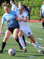 Detroit Country Day junior Erin Wycoff (2) battles