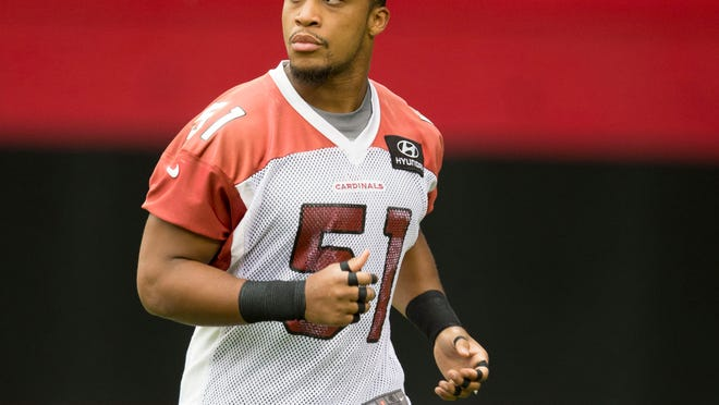 Cardinals linebacker Kevin Minter warms up during the first workouts of training camp at University of Phoenix Stadium in Saturday.