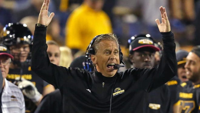 Southern Miss head coach Todd Monken reacts after his team scored a touchdown against North Texas Saturday at M.M. Roberts Stadium.