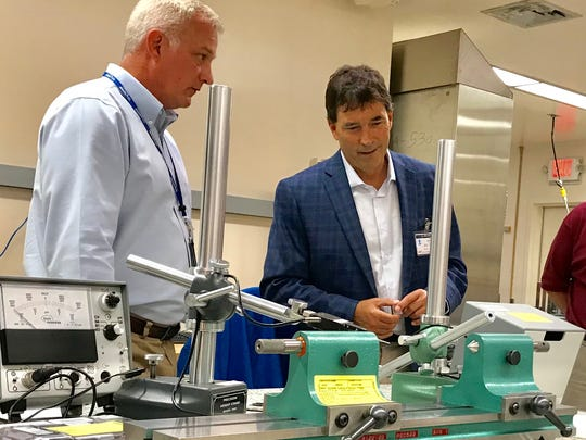 Troy Balderson (right) the Republican candidate for the 12th Congressional District, tours the Bionetics labs Friday at the Boeing Building on the Central Ohio Aerospace and Technology Center campus in Heath. Matthew Denslow (left) training and customer manager for Bionetics, led the tour.
