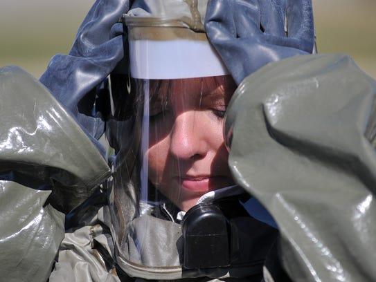 Tech Sgt. Sabrina Roberts puts on her hood during training
