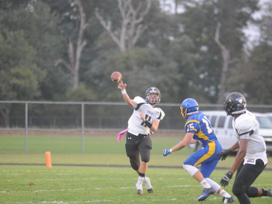 Sussex Tech's Justin Hill (11) tosses a pass downfield