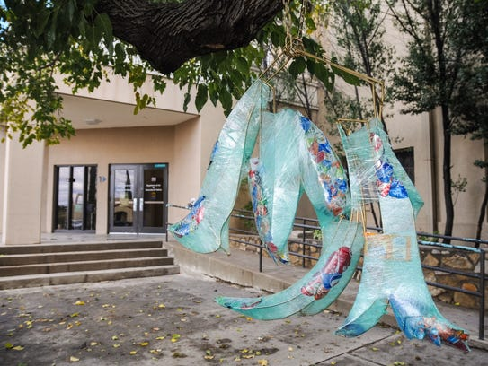 Art hangs in a tree outside of the New Mexico State