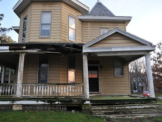 A vacant home at the intersection of West Mansfield