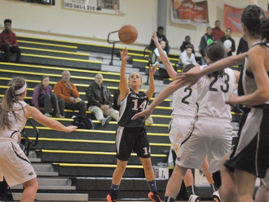 Salisbury School's Caroline Lewis takes a jump shot
