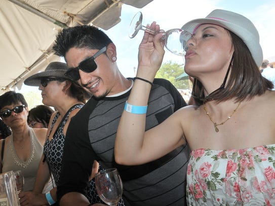Visitors sample wines at the Southern New Mexico Wine