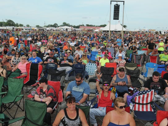Crowds listen to Warrant as they rock the stage at