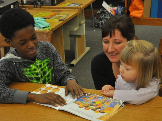 Thurston Woods Campus student Ionius reads to 2-year-old