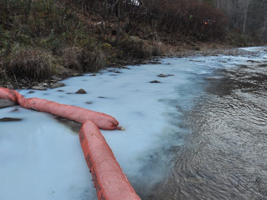 An oil-sorbent boom placed downstream did not collect