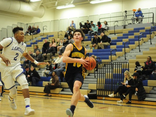 Port Huron Northern's Matt Baravik drives for a layup