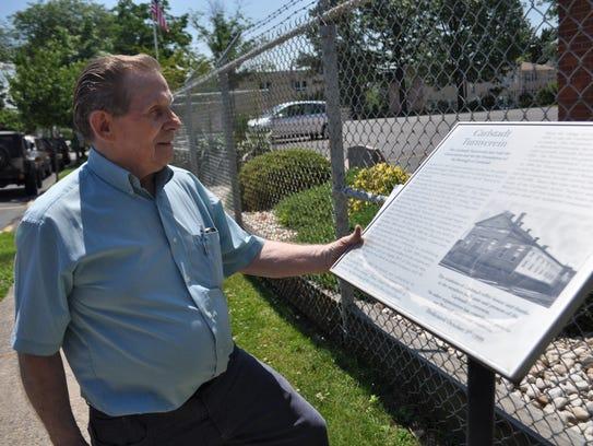 Gunter Kuprat, 81, examines a landmark description