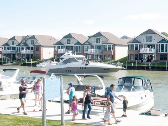 People walk along the River Street Marina during Family