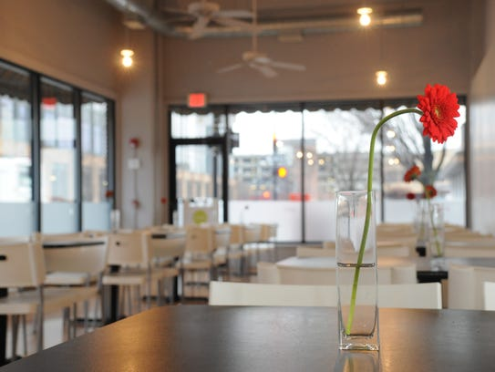 Tables at Proof await customers on a rainy afternoon.
