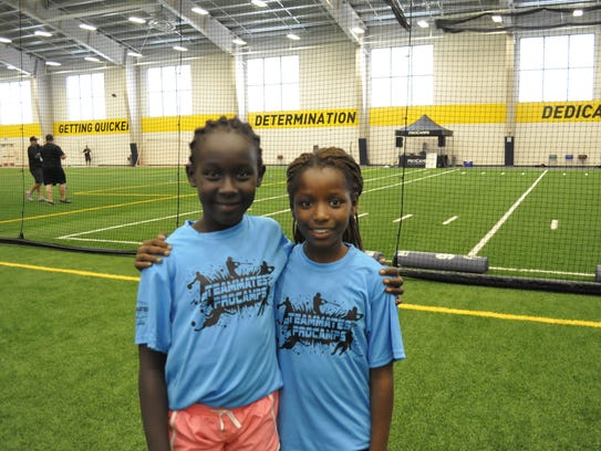 Aballa Gilo and Helen Paulo, both 10, went to the Teammates