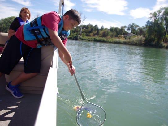 Ryan Jackson, 11, of Shasta Lake scoops up an errant