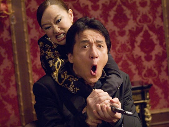 Youki Kudoh (left) and Jackie Chan in action in 'Rush