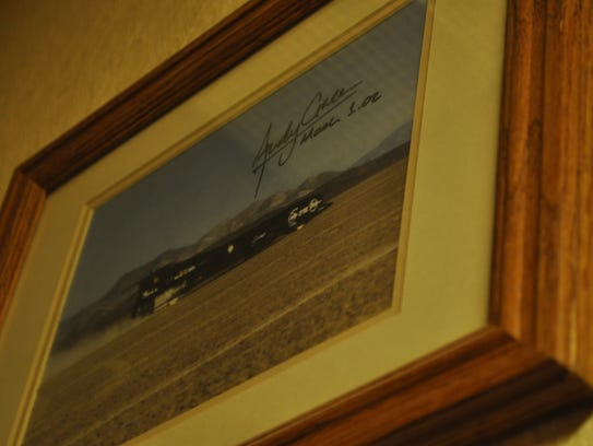 A framed photo of the Thrust SSC, signed by driver
